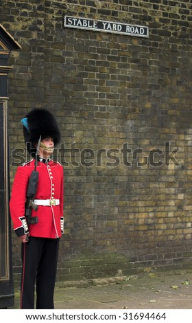 LONDON - JUNE 06: A Royal Guard at Stable Yard Road on 06 June 2009 in London, England. - stock photo