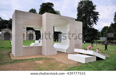 LONDON - JUNE 8, 2016. A Serpentine Gallery temporary summer house, designed by Kunle Adeyemi has an elevation equal to the plan of the temple in the background in Kensington Gardens, London.
