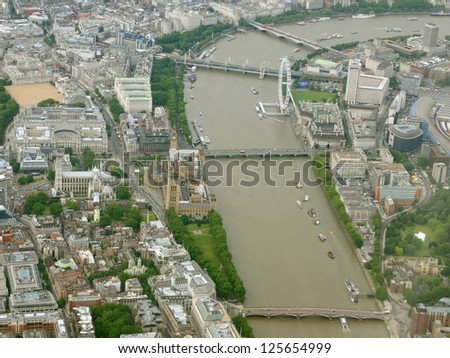 LONDON - JUNE 19: Aerial view of the River Thames as it runs through Westminster on June 19, 2010 in London, UK. The Thames is the longest river in England at 346 km. - stock photo