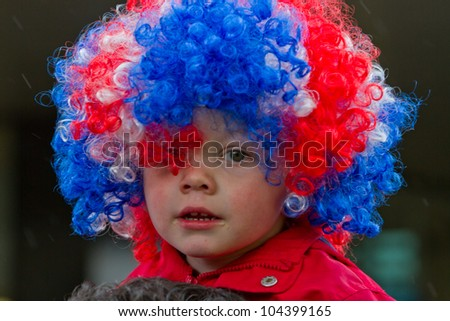 LONDON - JUNE 5: An unidentified boy with red, white and blue wig celebrates Diamond Jubilee celebrations on June 5, 2012 in London. - stock photo