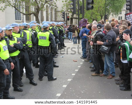 London - June 1: Anti fascists square up against the police during a BNP rally in Westminster, London June 1st, 2013 in London England.