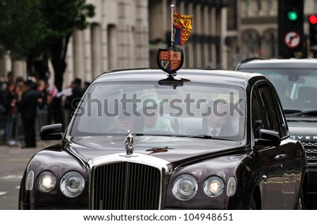 LONDON  JUNE 5 -  Britains Queen Elizabeth II drives in motorcade with The Lady Farnham, on her way to Westminster during the Queens 60TH Diamond Jubilee celebrations on June 5, 2012 in London. - stock photo