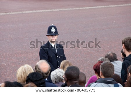 LONDON - JUNE 11: British police observe crowd of spectators during Trooping the Color ceremony, London, June 11, 2011. Ceremony is performed by regiments on occasion of the Queen's Official Birthday - stock photo