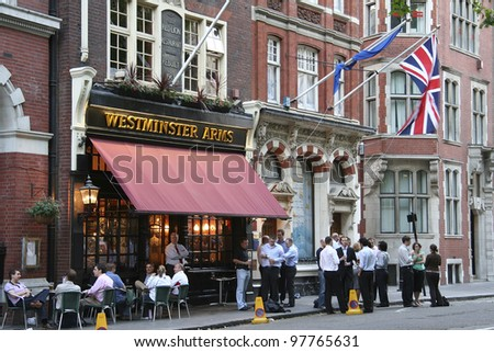 LONDON - JUNE 7: Exterior of pub, for drinking and socializing, focal point of the community, on June 7, 2006, London, UK. Pub business, now about 53,500 pubs in the UK, has been declining every year - stock photo
