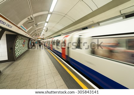 LONDON - JUNE 16: Inside view of London underground on June 16, 2015 in London, UK. London's system is the oldest underground railway in the world, dating back to 1863 - stock photo