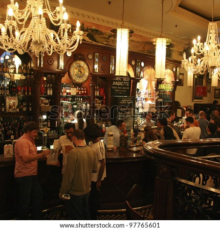 LONDON - JUNE 3: Inside view of pub, for drinking and socializing, focal point of the community, on June 3, 2006, London, UK. Pub business, now about 53,500 pubs in UK, has been declining every year - stock photo