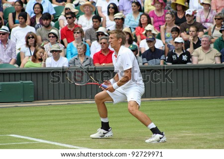 LONDON - JUNE 24: Jarkko Nieminen of Finland returns ball during second round match against Andy Murray of Scotland at Wimbledon in London, England on June 24, 2010 - stock photo