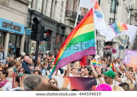 LONDON, JUNE 25, 2016: LGBT Gay Pride Parade, Crowd Of People With Waving Rainbow Flag. - stock photo