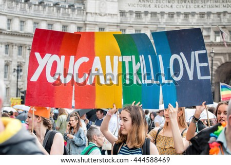 LONDON, JUNE 25, 2016: LGBT Gay Pride Parade Sign 'You Can't Kill Love' - stock photo