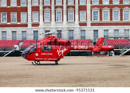 LONDON - JUNE 11: London's Air Ambulance chopper landed in Horse Guards Parade London, England on June 11, 2011. Air ambulance service responds to seriously ill or injured casualties in area of London