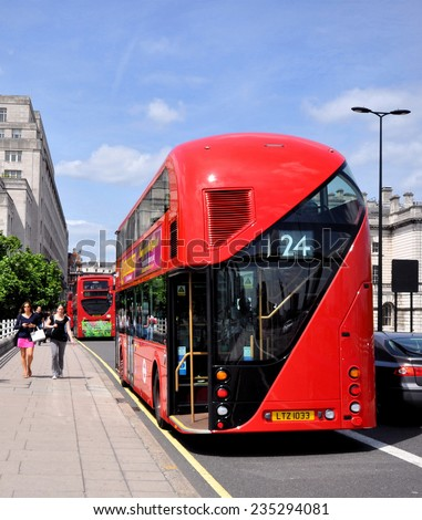 LONDON - JUNE 29. London's diesel-electric Routemaster double deck bus with three doorways and two staircases accommodates 80 passengers, June 29, 2013, on Waterloo Bridge, London, UK. - stock photo