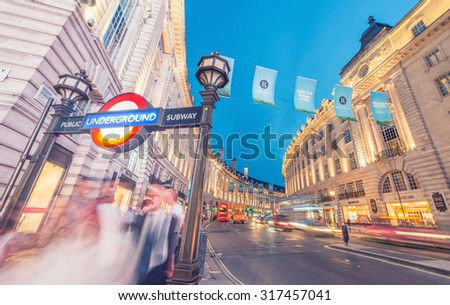 LONDON - JUNE 11, 2015: Night traffic and tourists in Regent Street. London is visited by 50 million people annually.