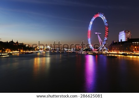 LONDON - JUNE 11 : Night View of London Skyline include London Eye on June 11, 2015 in London, UK. London Eye is a famous tourist attraction at a height of 135 metres biggest Ferris wheel in Europe.