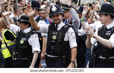 LONDON - JUNE 27: People take part in London's Gay Pride, 2015 Worldpride on June 27, 2015 in London, UK, estimated 25,000 people took part in the march, Parade to support gay rights.   - stock photo