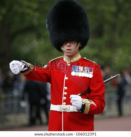LONDON - JUNE 16: Queen's Soldier at Queen's Birthday Parade on June 16, 2012 in London, England. Queen's Birthday Parade take place to Celebrate Queen's Official Birthday in every June in London. - stock photo
