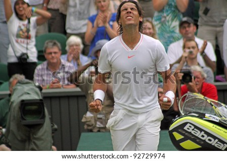 LONDON - JUNE 24: Rafael Nadal of Spain celebrates win against Robin Haase of the Netherlands in second round match at Wimbledon in London, England on June 24, 2010 - stock photo