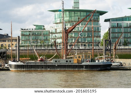 LONDON - JUNE 25 : Thames barge moored on the River Thames in London on June 25, 2014 - stock photo