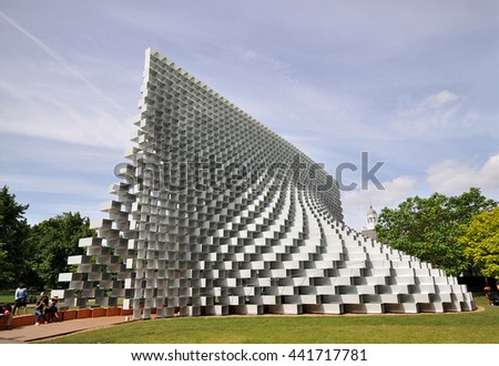 LONDON - JUNE 8, 2016. The Serpentine Gallery summer pavilion is designed by Danish architects BIG (Bjarke Ingels Group) with a structure of hollow fibreglass blocks in Kensington Gardens, London. - stock photo