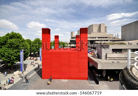 LONDON - JUNE 15. 'The Shed' is the National Theatre's temporary red timber venue celebrating performences that are adventurous, ambitious and unexpected, June 15, 2013, at the Southbank, London, UK. - stock photo