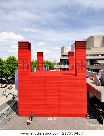 LONDON - JUNE 15. 'The Shed' is the National Theatre's temporary red timber venue that celebrates adventurous, ambitious and unexpected performances,  June 15, 2013 at the South Bank, London, UK. - stock photo