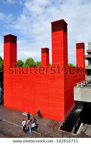 LONDON - JUNE 15. 'The Shed' is the National Theatre's temporary timber venue celebrating performances that are adventurous, ambitious and unexpected, on June 15, 2013, at the South Bank, London, UK. - stock photo