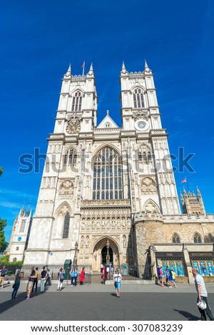 LONDON - JUNE 14, 2015: Tourists near Westminster Abbey. London is visited by 50 million people annually. - stock photo