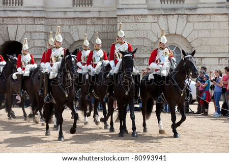 LONDON - JUNE 14: Unidentified members of The Queen's Life Guard or Horse Guard  participate in the changing ceremony in London, UK on June 14, 2011. Guard Mounting Ceremony is held daily during spring and summer. - stock photo