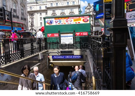 LONDON - JUNE 7, 2015:  Unidentified people at Piccadilly Circus  underground tube station.