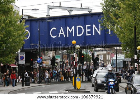 LONDON - JUNE 17: View of Camden Market, famous tourist attractions in Camden Town, also called Camden Lock. on June 17, 2012 in London, UK. The Market attracting about 100,000 visitors each weekend. - stock photo