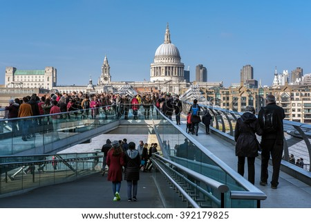 LONDON - MAR 13 : Millennium Bridge and St Pauls Cathedral in London on Mar 13, 2016. Unidentified people