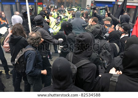 LONDON - MARCH 26: A breakaway group of protesters clash with police during a large anti-cuts rally on March 26, 2011 in London, UK. - stock photo