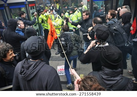 LONDON - MARCH 26: A group of breakaway protesters clash with police during a large austerity protest on March 26, 2011 in London, UK. An estimated 250,000 people joined the TUC organised rally. - stock photo