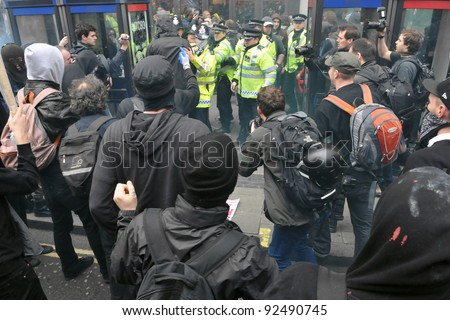 LONDON - MARCH 26: A group of breakaway protesters clash with police during a large austerity protest on March 26, 2011 in London, UK. - stock photo