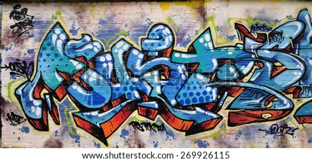 LONDON - MARCH 22, 2015. A painting on an old brick wall at Pedley Street, Shoreditch in the Borough of Tower Hamlets, an area renown for its street art in east London, UK. - stock photo