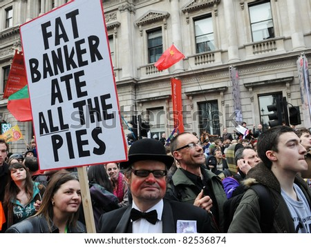 LONDON - MARCH 26: A protester dressed as a banker attends a large anti-cuts rally organised by the TUC March 26, 2011 in London, UK. - stock photo