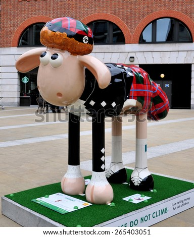 LONDON - MARCH 28, 2015. Aardman's Shaun the Sheep characters appear across the city before auctioning for a children's charity; HAMISH is a design by Ros Franklin at Paternoster Square, London. - stock photo