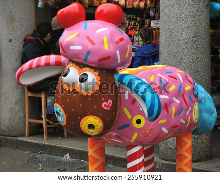 LONDON - MARCH 28, 2015. Aardman's Shaun the Sheep characters appear across the city before auctioning for a children's charity; CANDY BAA design by Emily Golden at Covent Garden, London. - stock photo