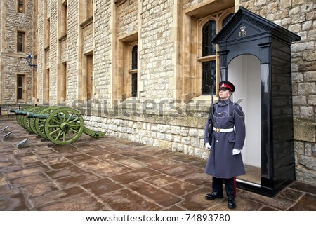 LONDON - MARCH 18: An unidentified  member of the England Military cadet stands guard at London Tower March 18, 2011 in London, England. They are in charged with guarding the official royal residences in London. - stock photo
