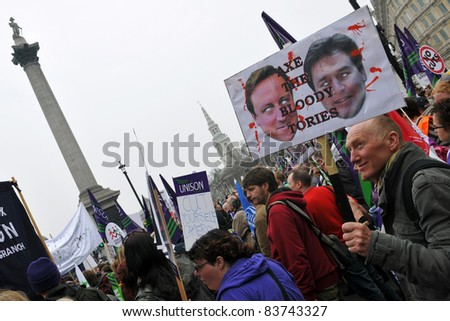 LONDON - MARCH 26: Anti-cuts protesters converge on Trafalgar Square on March 26, 2011 in London, UK. The TUC organised rally drew an estimated 250,000 to the British capital. - stock photo