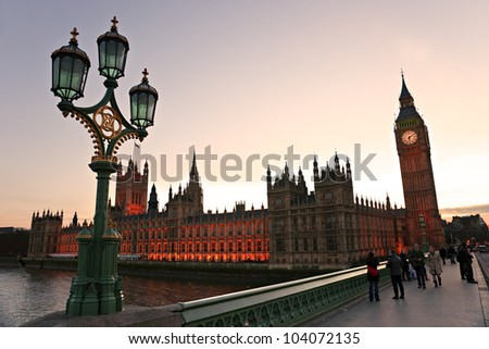 LONDON - MARCH 17: Big Ben and house of Parliament in early evening in London, England on March 17, 2011. The bell in Big Ben is 2.28 meters tall (7 feet six inches) and 2.75 meters wide (9 feet). - stock photo