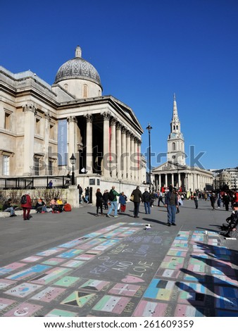 LONDON - MARCH 6, 2015. Chalked street art flags welcome visitors to Trafalgar Square, the National Gallery and St Martin's in the Fields Church beyond in central London, UK. - stock photo