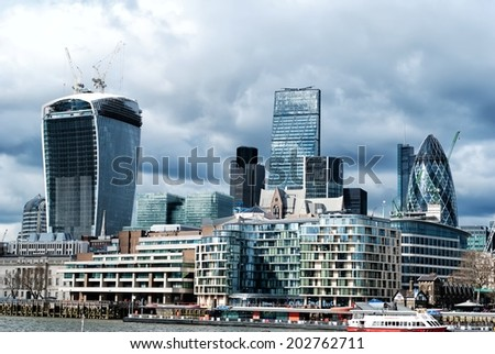 LONDON - MARCH 23: City of London on March 23, 2014. The City is a tiny part of the metropolis of the London region. It holds city status in its own right and is also a separate ceremonial county. - stock photo