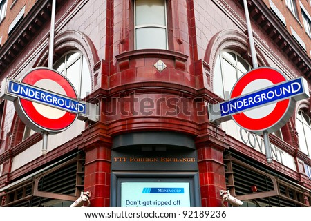 LONDON – MARCH 15: Close up of a traditional station sign for the London Underground transportation systems on March 15, 2011 in London. The sign was first used in 1908. - stock photo