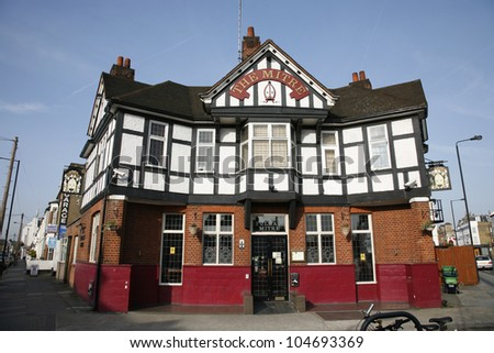 LONDON - MARCH 29: Exterior of pub, for drinking and socializing, focal point of community, on March 29, 2012, London, UK. Pub business, now about 53,500 pubs in the UK, has been declining every year - stock photo