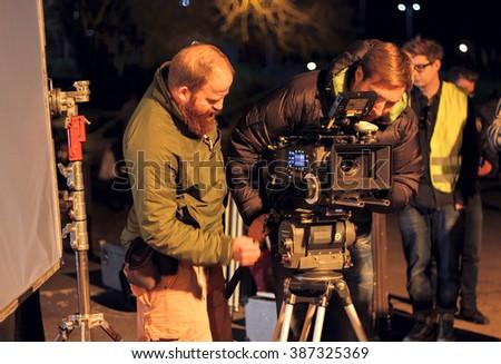 LONDON - MARCH 30, 2012: Film Crew On Location Night Shoot. 4K Camera & Cinematographer. Filmmaking.   - stock photo