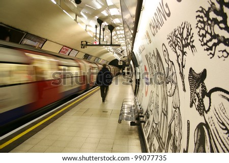 LONDON - MARCH 4: Inside view of London Underground, oldest underground railway in the world, covering 402 km of tracks, on March 4, 2006 in London, UK. - stock photo