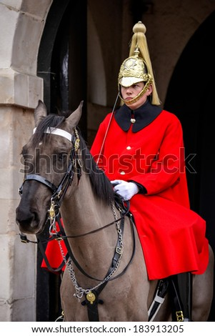 LONDON - MARCH 6 : Lifeguard of the Queens Household Cavalry on duty in London on March 6, 2013 - stock photo