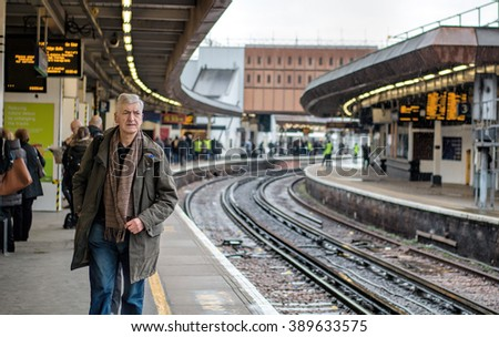 LONDON - MARCH 9, 2016: London Bridge Railway Station, Man On Platform. - stock photo