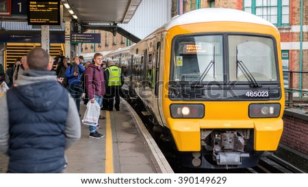 LONDON - MARCH 9, 2016:  London Bridge Station, Train Arriving With People Waiting To Board. - stock photo