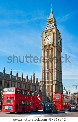 LONDON - MARCH 19:  London Buses with Big Ben on March 19, 2011 in London, England. The London Bus service is one of the largest urban bus networks in the world with 8,000 buses covering 700 routes. - stock photo